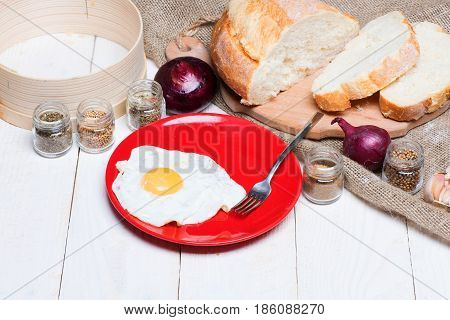 Fried Egg On Red Plate