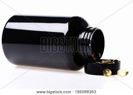 Fish Oil With Vitamin In Black Plastic Jar