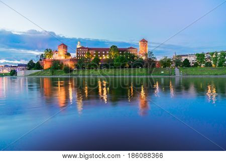 Old town of Krakow, Wawel hill with castle illuminated at night, Krakow, Poland poster