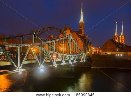 old town of Wroclaw - bridge to island Tumski illuminated at night, Poland