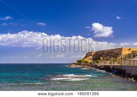 Fortezza Castle - Venetian fortress on hill Paleokastro in resort Rethymno. Greek architecture on coast of Kolpos Almirou. Promenade Leof. Emmanouil Kefalogianni washed by Cretan sea. Crete Greece