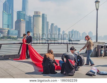Shanghai, China - Nov 4, 2016: Along The Bund Sightseeing Avenue; a wedding photo shoot taking place. Popular destination for local and foreign visitors.