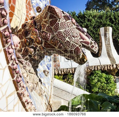 Barcelona, Spain - May 7, 2017: Park Guell dragon mosaic sculpture, Barcelona, Spain. Designed by Antoni Gaudi