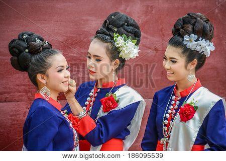 NAKORN PHANOM THAILAND - FEBRUARY 14 2015: Thai northeastern Phutai dancers with traditional costume in Phutai world event day in Renunakorn of Nakorn Phanom Thailand.