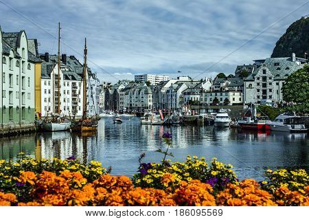 Alesund, Norway - May 7, 2017: Seafront of town and sea port Alesund