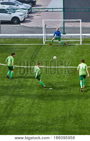 Soccer football goalkeeper making diving save on green fuild