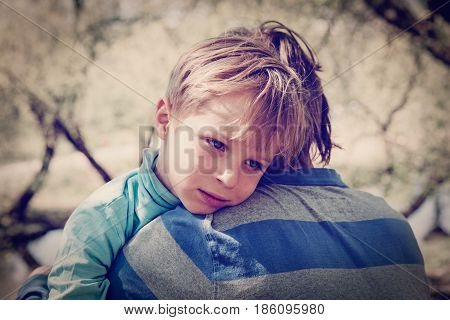 Sad crying son hugging father, concept of sorrow