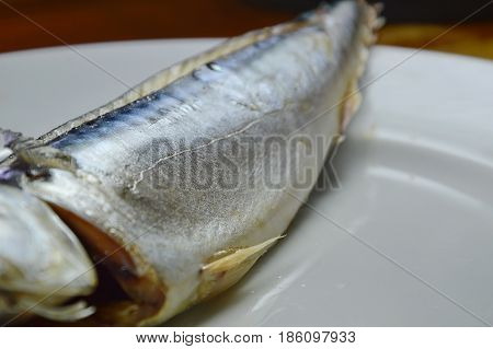 steamed Saba fish skin on white plate