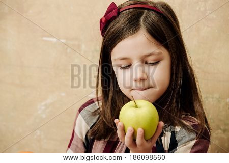 Cute Girl With Adorable Face Eating Vitamin Apple