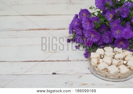Flowers and sweet candies on wooden background, Valentines Day background, wedding day, women's day