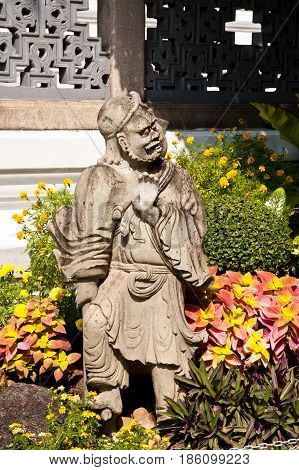 Thai buddha statue in thai temple garden