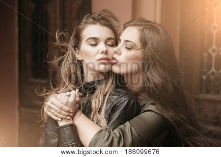 Two Pretty Women With Closed Eyes Hugging