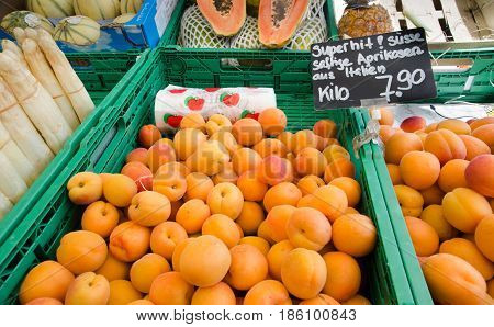 Red And Orange Apricots For Sale  At City Market. Lucerne, Switzerland