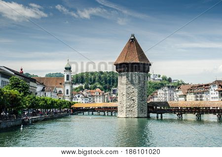 Water Tower And Chapel Bridge (kapellbrucke) - Covered Wooden Footbridge In Lucerne, Switzerland
