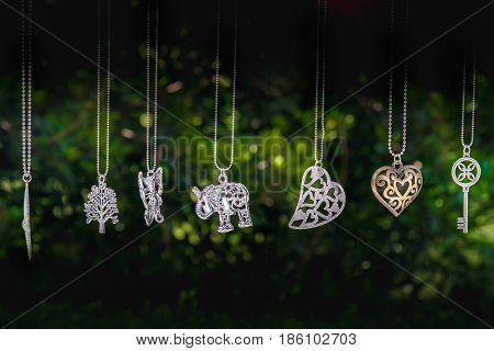 necklaces hang elephant key heart green background