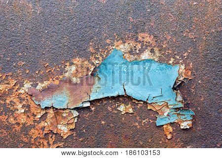 Old exfoliated paint and texture of rusty metal as a background
