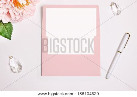 Pink envelope with an opened rectangular flip stationery Mockup. Wax seal pen flower and wedding decoration.