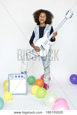 Kid playing guitar solo style