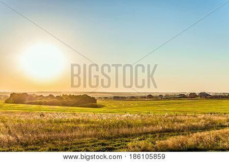 Rural landscape in light of the low evening sun backlight. Belgorod region Russia.