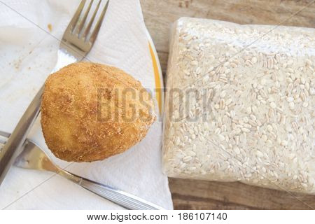 fried sicilian rice balls called arancino stuffed with ragout