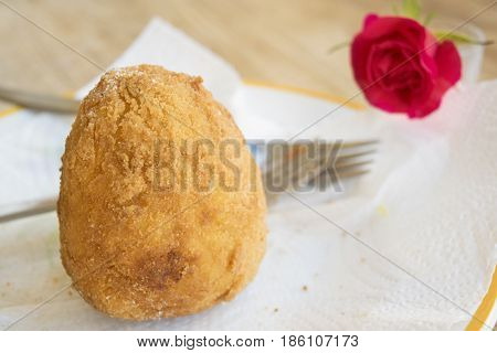 fried sicilian rice balls called arancino filled with ragout