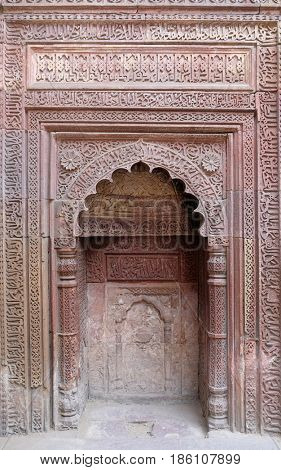 DELHI, INDIA - FEBRUARY 13: Stone carving on Qutab Minar, Delhi, India on February, 13, 2016.