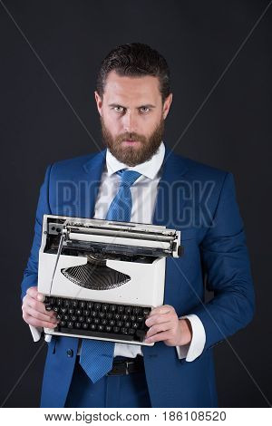Man With Typewriter In Fashion Business Suit