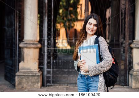 Smiling Pretty Young Woman Student With Backpack Walking Outdoors Near Campus