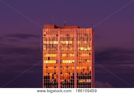 Building With Windows In Golden Color At Sunset
