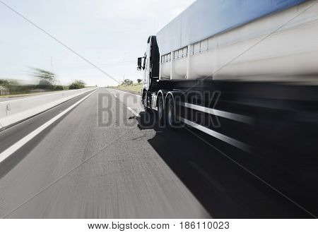 Big Truck Driving On The Highway