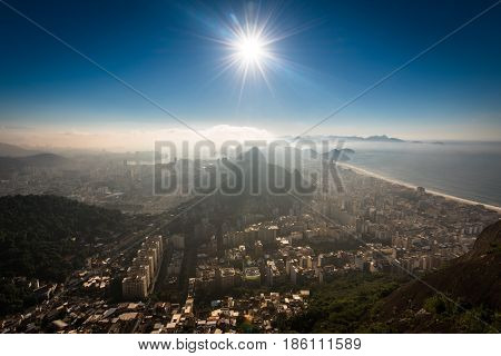 Aerial View of Copacabana District, the Sugarloaf Mountain in the Horizon, Sun Shines Above, Rio de Janeiro, Brazil