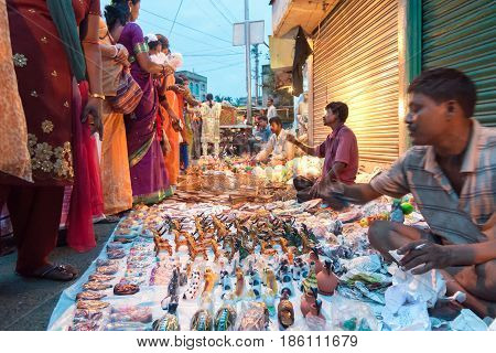 KOLKATA WEST BENGAL INDIA - 12TH AUGUST 2012 : Indian woman choosing ornaments from out door local market place. India is boomimg with middle class consumers in society.