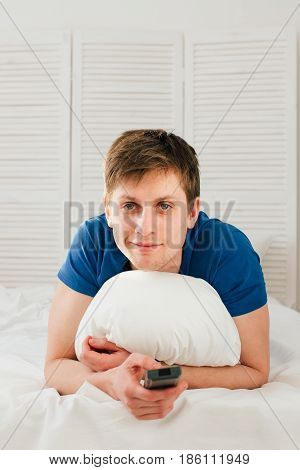 Man Watching Tv Lying On The Bed
