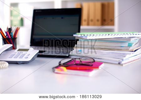 Points on the office desktop with a computer and documents.