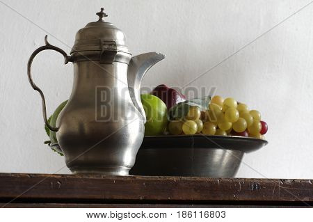 tin pitcher and a fruit bowl still life
