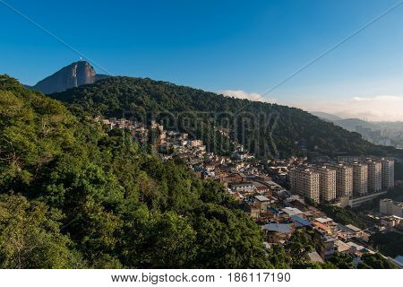 Rio de Janeiro Mountains with Slums and Corcovado with Christ the Redeemer statue