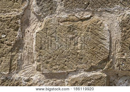 detail of wall built with stone blocks carved by hand, subsequently restored, Romanesque centuries XI, XII