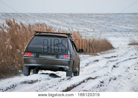 The car on a winter dirt road.