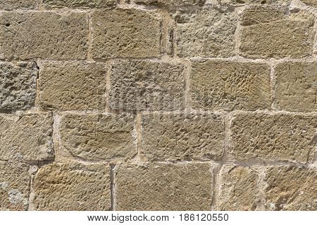 Wall built with blocks of hand carved stone, subsequently restored, Romanesque XI century, XII