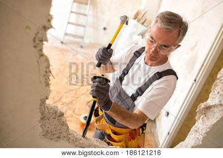 Construction Man Using Hammer