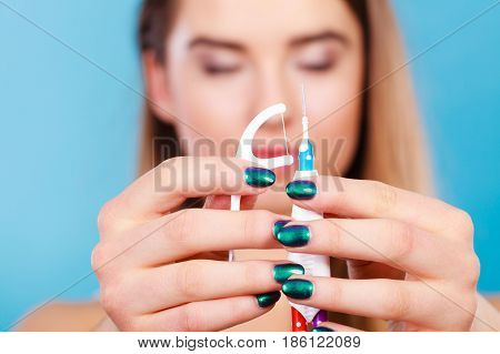 Oral mouth hygiene routine concept. Woman holding small toothbrush and dental floss