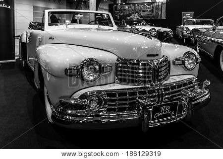 STUTTGART GERMANY - MARCH 02 2017: Personal luxury car Lincoln Continental cabriolet 1948. Black and white. Europe's greatest classic car exhibition