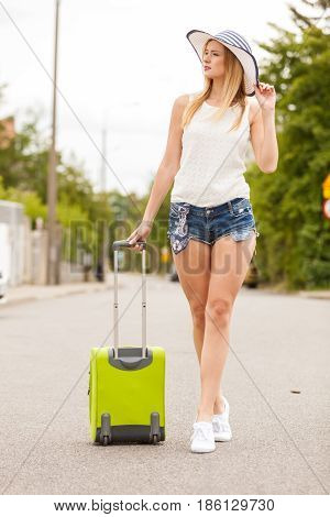 Attractive Woman Tourist Walking With Green Suitcase