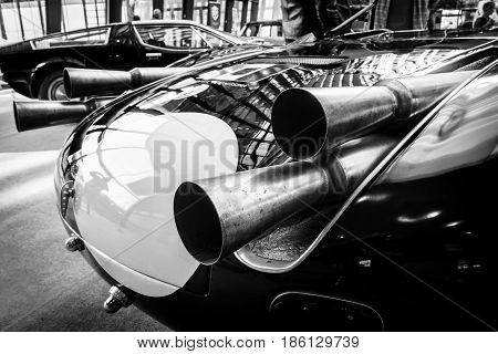 STUTTGART GERMANY - MARCH 02 2017: Exhaust pipes of a sports racing car Maserati Tipo 63 (Birdcage) 1959. Scuderia Serenissima. Black and white. Europe's greatest classic car exhibition