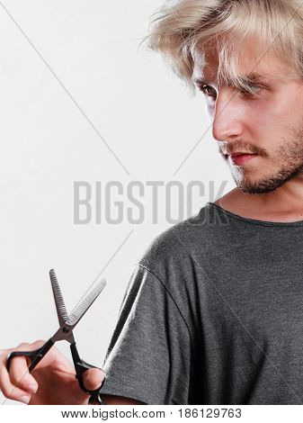 Man With Scissors Texturizing Or Thinning Shears