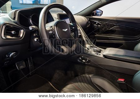 STUTTGART GERMANY - MARCH 02 2017: The interior of the grand tourer car Aston Martin DB11 2016. Europe's greatest classic car exhibition