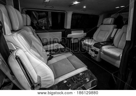 STUTTGART GERMANY - MARCH 02 2017: Interior of a passenger compartment Volkswagen Multivan Business. Black and white. Europe's greatest classic car exhibition