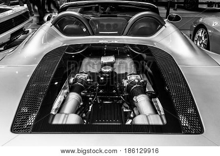 STUTTGART GERMANY - MARCH 02 2017: Engine compartment of the Ferrari 360 Spider. Black and white. Europe's greatest classic car exhibition