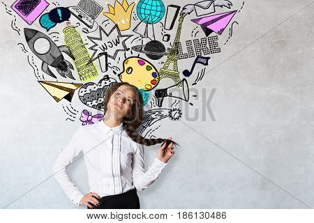 Daydreaming young woman on concrete background with social media sketch