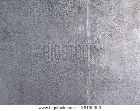 Silver painted aged metallic background with rivets